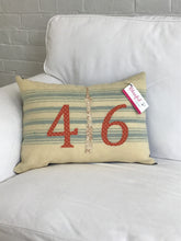 Load image into Gallery viewer, Cream pillow with blue stripes. Rust numbers and cream CN Tower