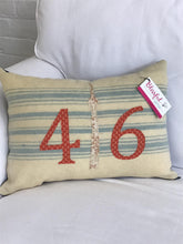 Load image into Gallery viewer, Felted Wool Blanket Pillow - Cream background with multiple robins egg blue stripes. Rust colored numbers and mottled cream CN Tower