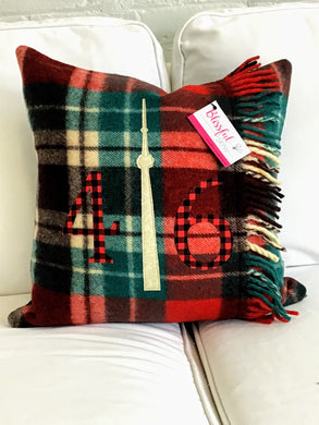 Felted Wool Blanket Pillow - Christmasy plaid background with red check numbers and CN Tower.