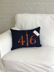Dark navy denim front and back pillow with cranberry pink, brown and rust numbers and CN Tower.