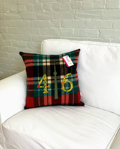 Christmasy plaid with mustard numbers and green CN Tower.