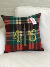 Load image into Gallery viewer, Felted Wool Blanket Pillow - Christmasy plaid background with floral mustard numbers and green check CN Tower.