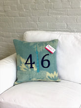 Load image into Gallery viewer, Modern aqua and cream pillow with navy numbers and teal CN Tower.