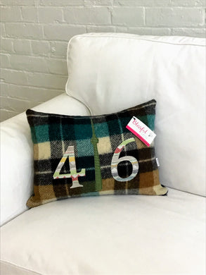 Felted Wool Blanket Pillow - Cream,black, caramel and moss green plaid background with multi colored off white numbers and green check CN Tower.