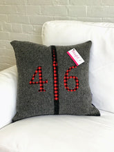 Load image into Gallery viewer, Felted Wool Blanket Pillow - Dark grey background with thick black vertical stripe.  Red plaid numbers and CN Tower.