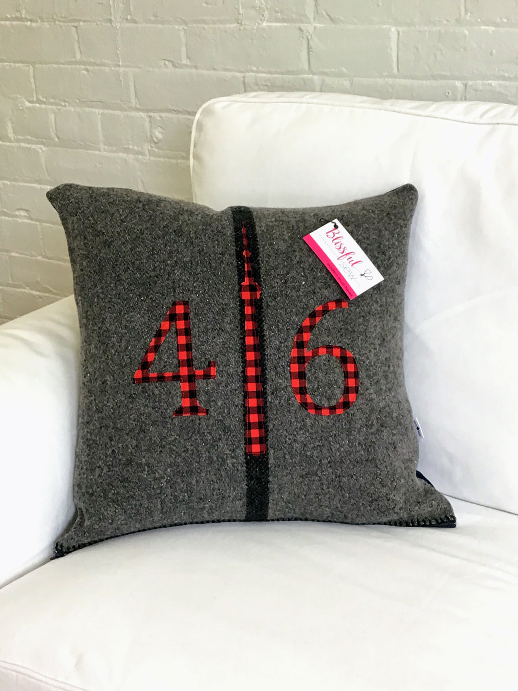 Felted Wool Blanket Pillow - Dark grey background with thick black vertical stripe.  Red plaid numbers and CN Tower.