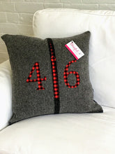 Load image into Gallery viewer, Dark grey pillow with modern black stripe.  Red plaid numbers and CN Tower.