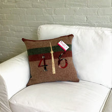 Load image into Gallery viewer, Felted Wool Blanket Pillow - Light brown background with thick maroon and moss green stripes. maroon plaid numbers and cream/brown CN Tower.