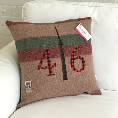 Felted Wool Blanket Pillow - Light brown background with thick maroon and moss green stripes with red plaid numbers and chocolate brown and moss green check CN Tower.