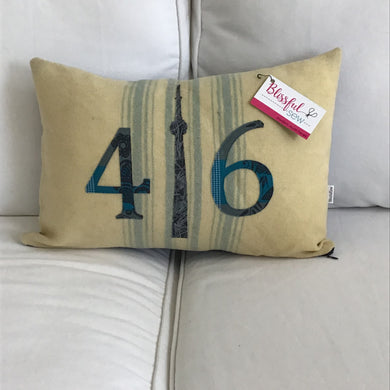 Felted Wool Blanket Pillow - Cream background with multiple robins egg blue stripes. Grey and blue mini dot numbers with coordinating grey and blue striped CN Tower