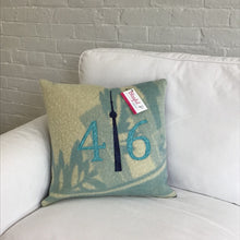 Load image into Gallery viewer, Felted Wool Blanket Pillow - Robins egg blue and cream modern background with teal patterned numbers and mottled navy CN Tower.