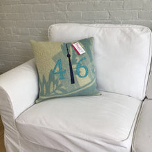 Load image into Gallery viewer, Modern aqua and cream pillow with teal numbers and navy CN Tower.