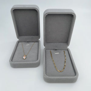 Two grey velvet necklaces boxes, open and placed side by side