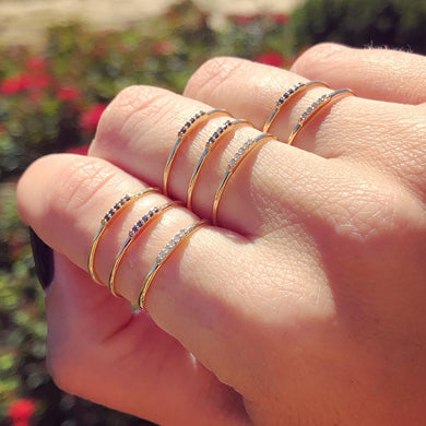 Stacking rings, gold and diamonds, on hand