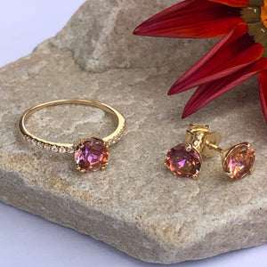Anastasia Topaz Ring and Studs on rock with red flower