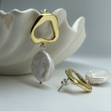 Darling Earrings shown on white ceramic bowl