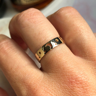 10kt solid gold celestial ring with stars and moon motif, modelled on hand