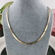 Load image into Gallery viewer, Gold Snake Chain on grey silver bust