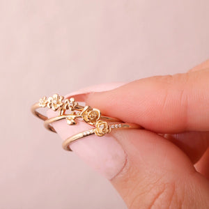 La Kaiser rings, solid gold with natural diamonds. Dainty, floral, daisies, roses. Stacking rings