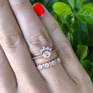 Rose gold and gemstone stacking rings on hand