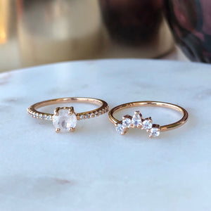 Two rose gold Stacking rings on marble