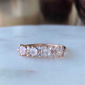 Rose gold band with simulated diamonds and rainbow moostones