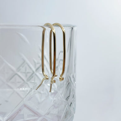 Collective & Co. 9kt Gold Paperclip Earrings on glass