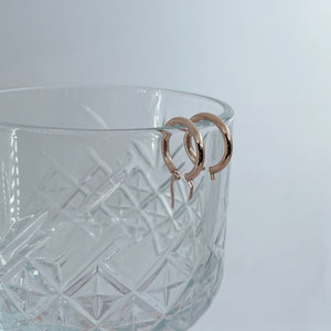 Collective & Co. 9kt Rose Gold Amelia Hoops on glass