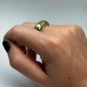 Extra thick brass ring shown on female hand