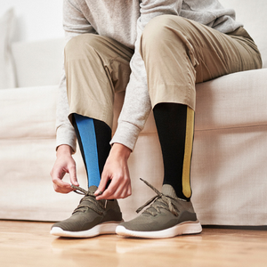 How do compression socks work to keep your legs energized without moving them?