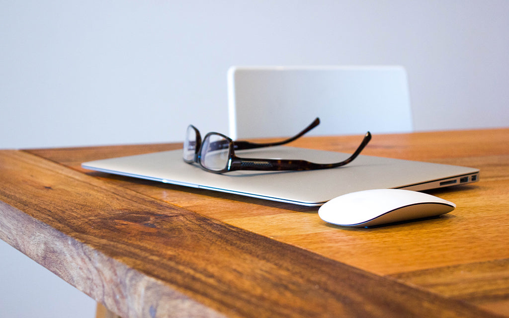 Pair of glasses on a computer
