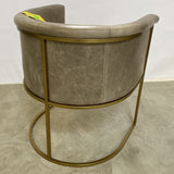 High-End Tan Leather Barrel-Back Armchair with Brass Colored Legs and Frame