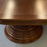 Oval shaped double pedestal dining table in cherry seats 12.