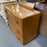 Vintage art deco wooden dresser with x shaped knobs and oval mirror.