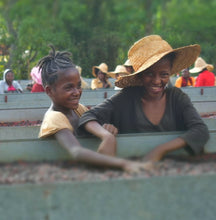Load image into Gallery viewer, kids drying coffee cherries ethiopia