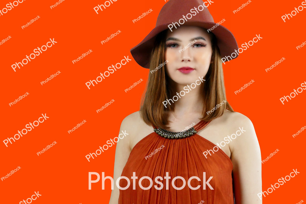 Young female model posing on red background