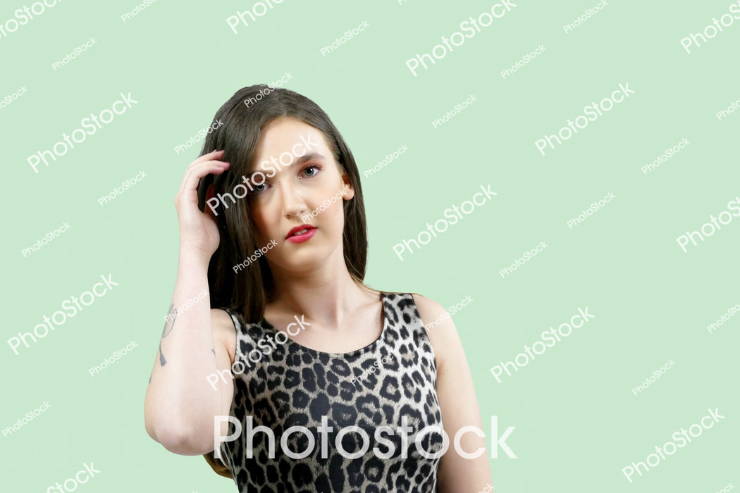Young woman in sleeveless animal print top
