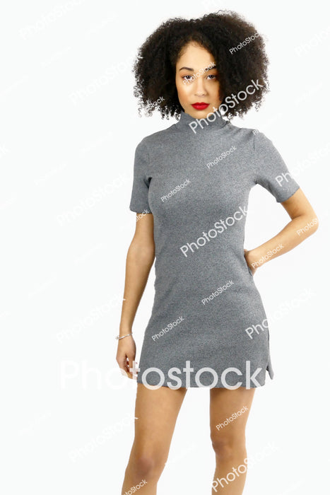 Women model posing in grey dress