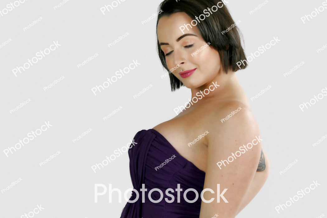 Young woman posing in purple top