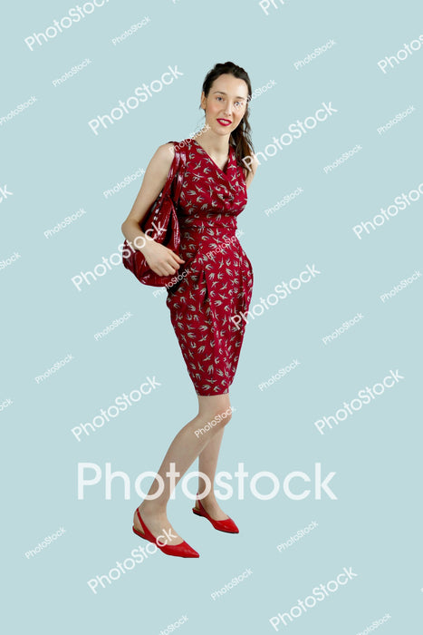 Woman in red outfit posing with handbag