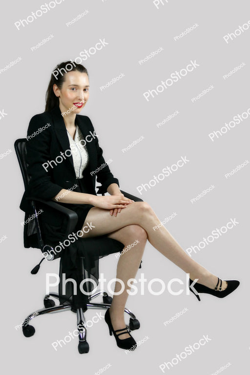 Woman in a blazer sitting in  office chair