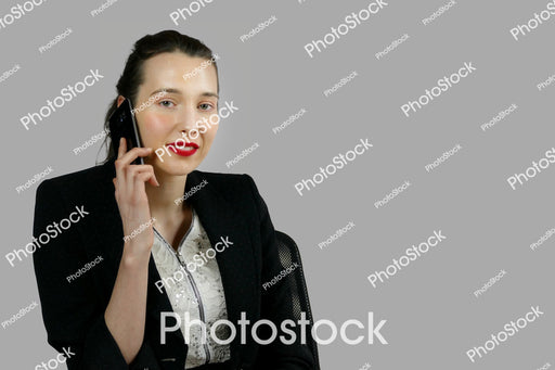 Woman in office clothes on mobile phone