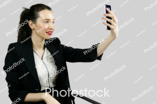 Woman in office clothes taking a selfie