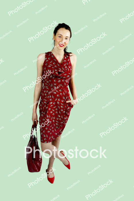 Young woman in red dress with red handbag