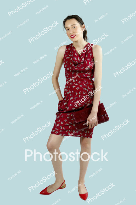Young woman in sleeveless red dress
