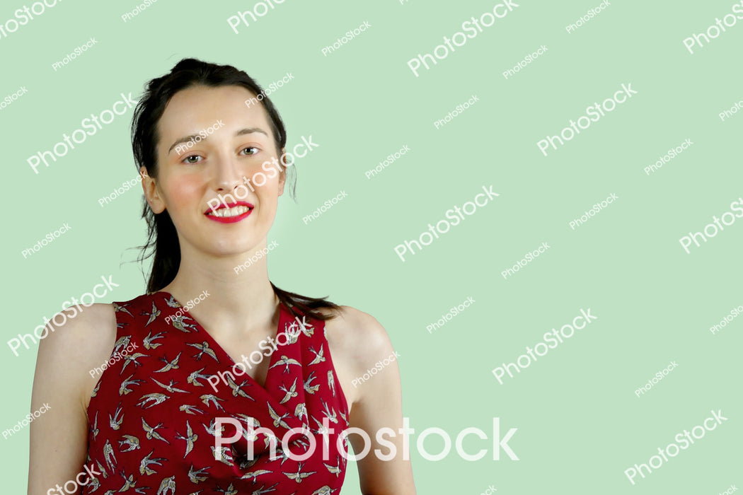 Young woman in sleeveless red top