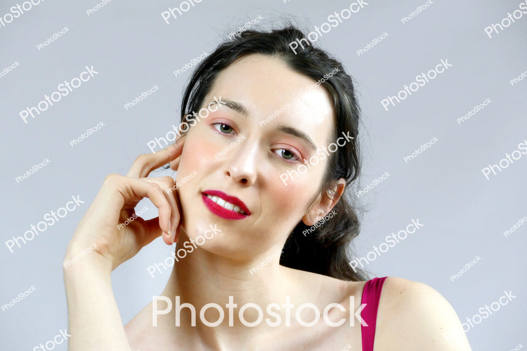 Young woman posing with hand to face