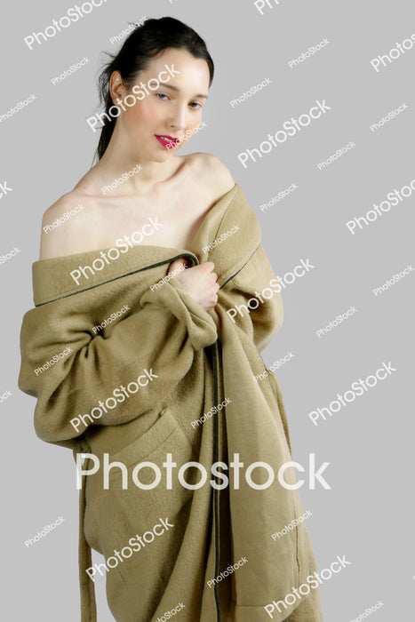 Woman with dressing gown off shoulders