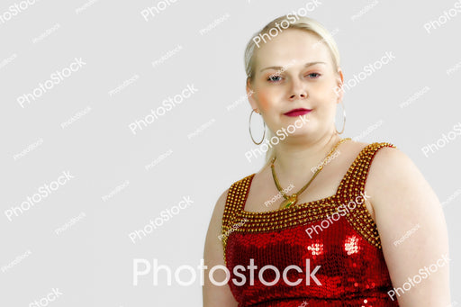 Blonde haired woman posing in red sequin top