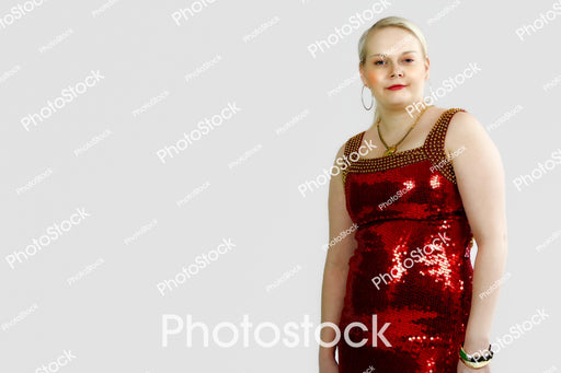 Blonde haired woman posing in red sequin dress